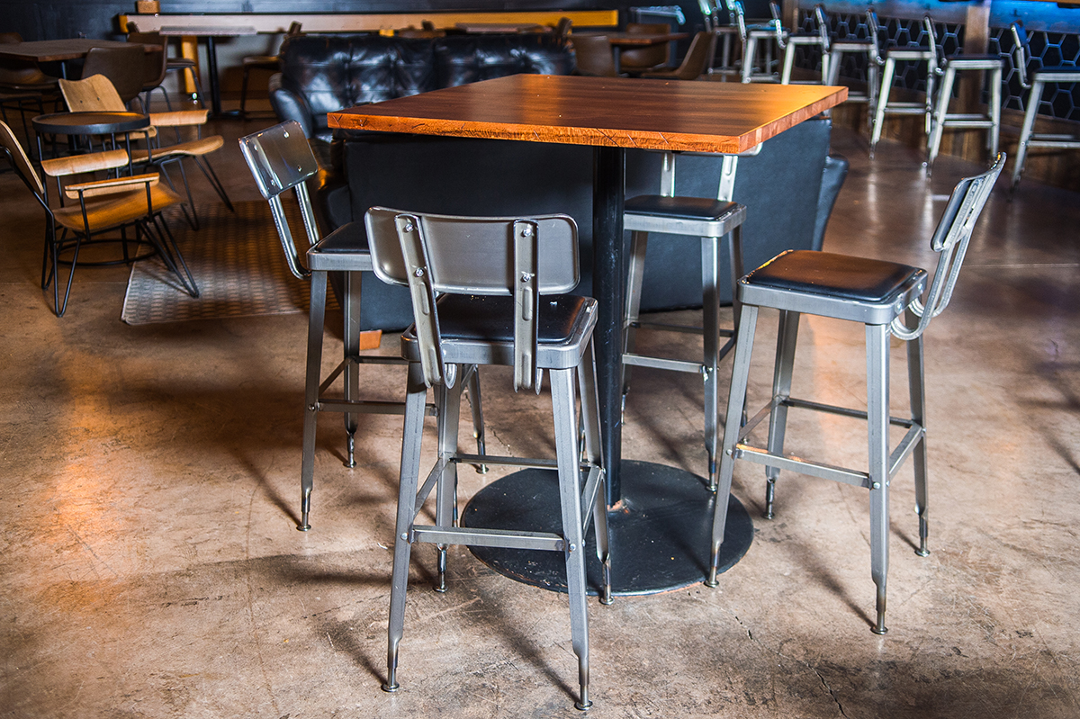 restaurant bar stools and wood tables