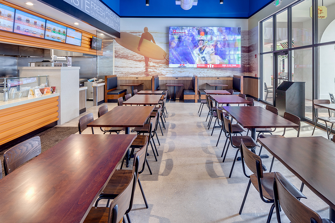 restaurant booths, chairs and wood table tops